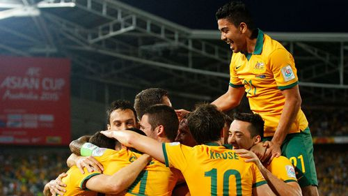 Socceroos through to Asian Cup quarter finals after trouncing Oman