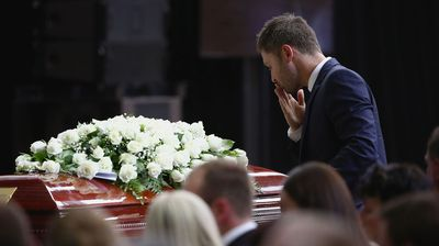 Australian cricket captain Michael Clarke pays his respect to Phillip Hughes during the service. (AAP)