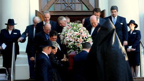 The coffin of murdered Royal North Shore nursing manager Michelle Beets is carried out of Our Lady of Dolours church after her funeral in Chatswood, Sydney. (AAP)