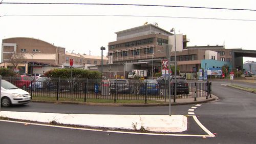 A man who allegedly threatened police officers with two knives was shot in the stomach at Sydney's Nepean Hospital.