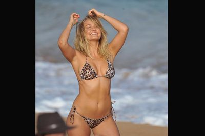 """Since the days of """"Where the bloody hell are you?"""" the name Lara Bingle has become synonymous with swimwear. Now, the fit 26-year-old model is stepping back into her signature garment in a new collaboration with Cotton On Body. Check out these scorching hot pictures from her latest beach shoot! <br/>Images: Matrix"""