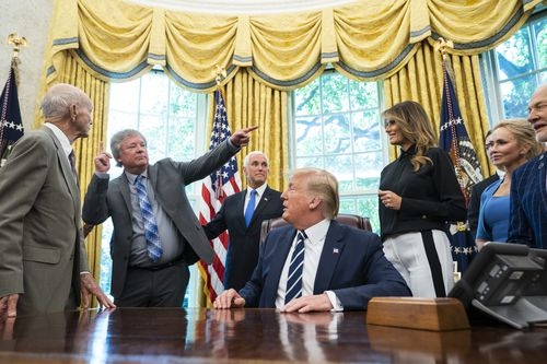 US President Donald J. Trump welcomes astronauts Buzz Aldrin (R), Michael Collins (L), and Andrew Armstrong (C-L), the son of Neil Armstrong, to the Oval Office honor the 50th anniversary of the Apollo moon landing in the Oval Office of the White House.