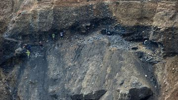 Miners digging for raw jade stones, next to a jade mine in Hpakant, Myanmar's Kachin State. (AFP)