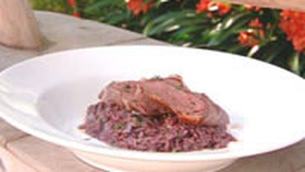 Raddiccio and red wine risotto with lamb loins in prosciutto