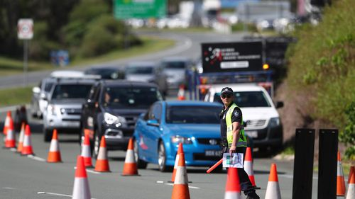 Queensland Police stop vehicles at a Police checkpoint set up at the Queensland and New South Wales border in March on the Gold Coast, Australia.