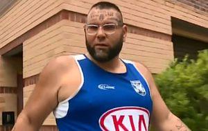 Tattooed man charged over John Ibrahim threats