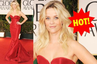 Reese smoulders in floor-length red, and check out those curves!