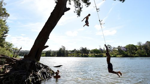 Children cool off in the Nepean River at Penrith.