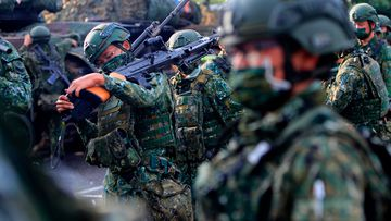 Taiwanese soldiers prepare grenade launchers, machine guns and tanks for the Han Kuang drill for simulation in the event of China's invasion. (Photo by Ceng Shou Yi/NurPhoto via AP)