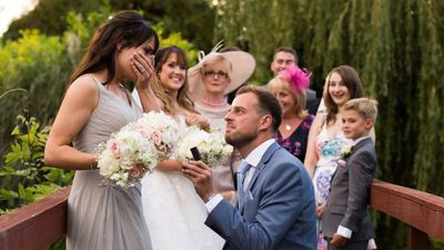 Twin steals the limelight on sister's wedding day by getting engaged