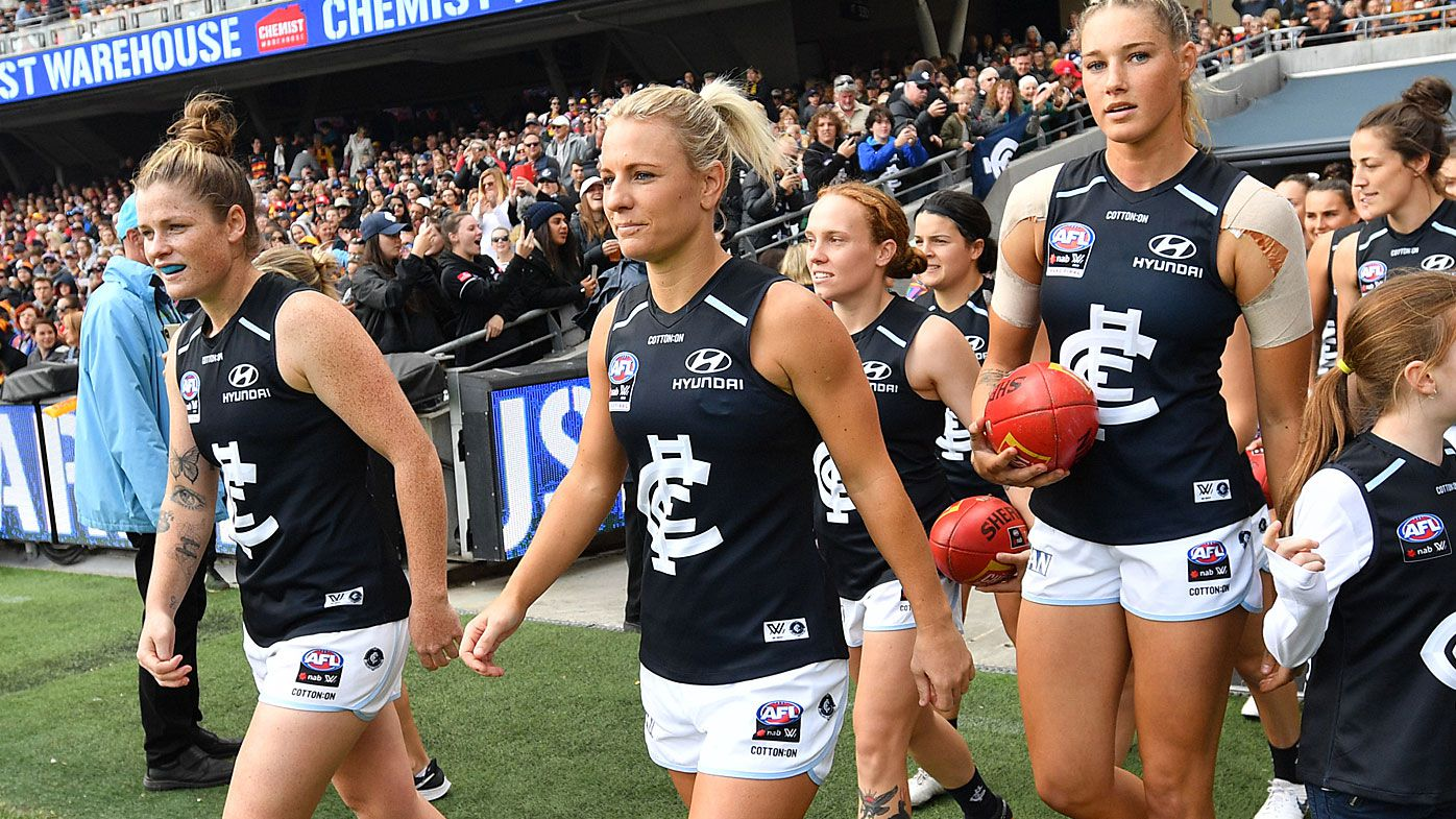 Blues players walk onto the field during the AFLW Grand Final match between the Adelaide Crows and Carlton Blues at the Adelaide Oval