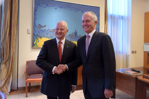 Phillip Ruddock (left) shakes hands with Prime Minister Malcolm Turnbull at parliament last year. (AAP)