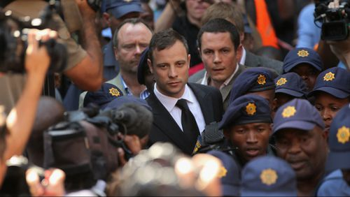 Oscar Pistorius struggles through the crowd as he leaves court. (Getty)