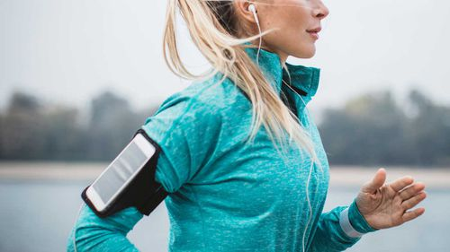 Woman running with headphones