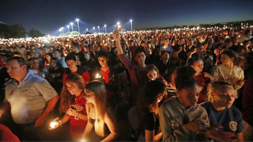 Hundreds gather for a memorial for the students killed in the Florida gunman's rampage. (AAP)