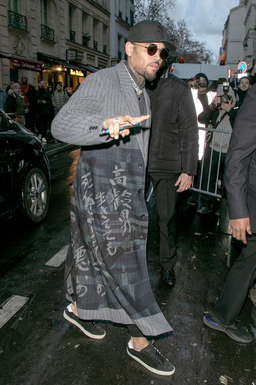 Chris Brown is seen on January 17 - it's not known what he was doing in France.
