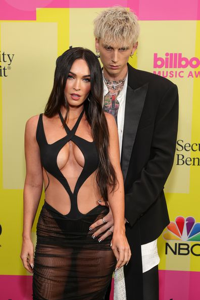 Machine Gun Kelly and Meghan Fox poses backstage for the 2021 Billboard Music Awards, broadcast on May 23, 2021 at Microsoft Theater in Los Angeles, California.