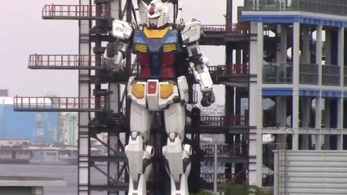 The 60 foot tall robot has over 200 pieced and can walk and kneel