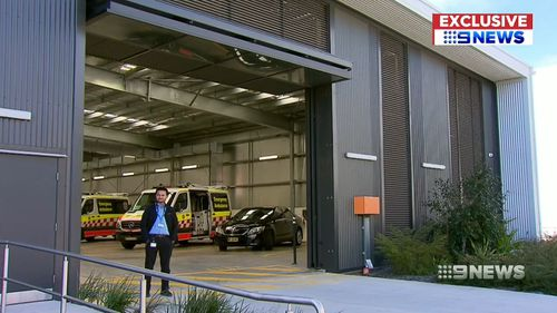 Security outside a NSW Ambulance station.