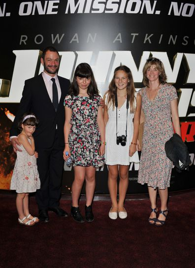 Catherine Fitzgerald and Dominic West attend the Johnny English Reborn UK premiere with their children in 2011