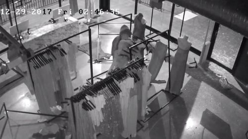 The thieves were caught snatching the designer clothing from the racks. (NSW Police)