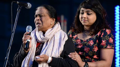 Edith Visvanathan, (left), the grandmother of Myuran Sukumaran, speaks at a candlelight vigil in Sydney's Martin Place. (AAP)