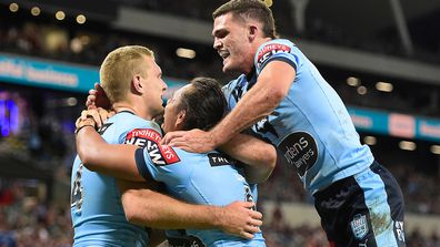 Tom Trbojevic of the Blues celebrates with team mates after scoring a try during game one of the 2021 State of Origin series between the New South Wales Blues and the Queensland Maroons at Queensland Country Bank Stadium on June 09, 2021 in Townsville, Australia. (Photo by Ian Hitchcock/Getty Images)