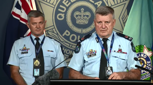 Senior Constable Neill Scutts (L) and Assistant Commissioner Michael Condon (R).