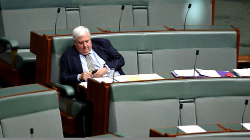 Clive Palmer takes to texts to register his response. (AAP)