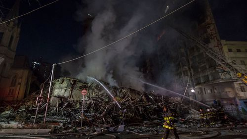 At least one dead as burning building collapses during massive blaze in Sao Paolo, Brazil.