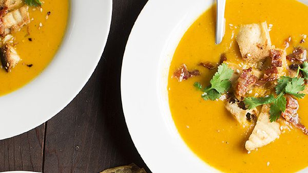 Korma and butternut soup with crispy bacon and sesame naan croutons