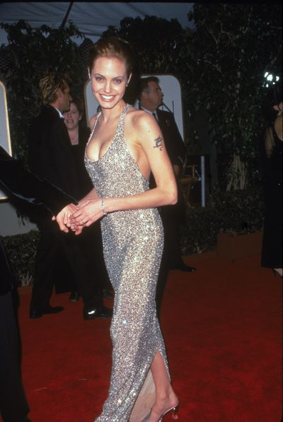 Angelina Jolie wearing Randolph Duke at the 56th Annual Golden Globe Awards in Beverly Hills, January, 1999