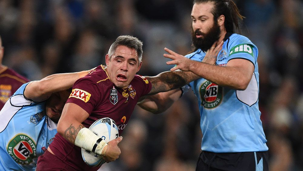 Woods (right) says his long-time Origin rival deserves an international farewell. (AAP)