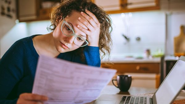 Woman reading financial statements