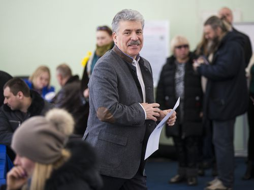 Communist party candidate Pavel Grudinin casting his vote in the election. (AAP)