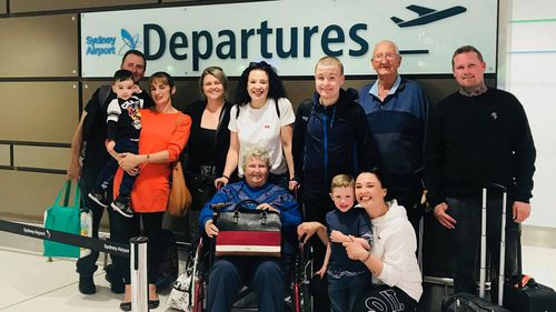 Patricia Hardy (centre) and her family before heading off on her bucket list holiday to Hawaii.