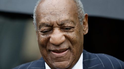 Once-loved entertainer Cosby managed a familiar smirk as he entered the court house.