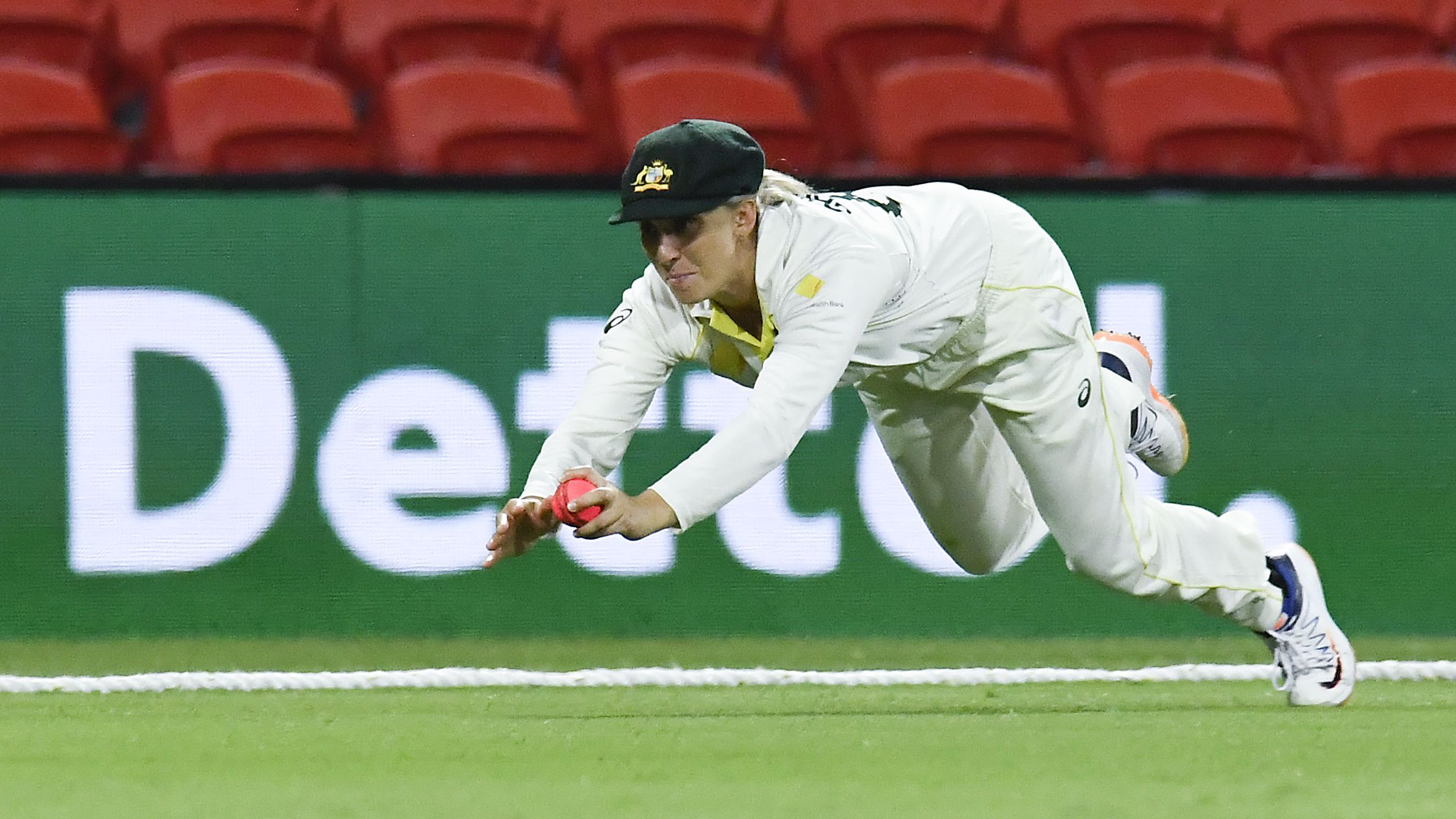 Ashleigh Gardner of Australia catches out Smriti Mandhana of India during day four.