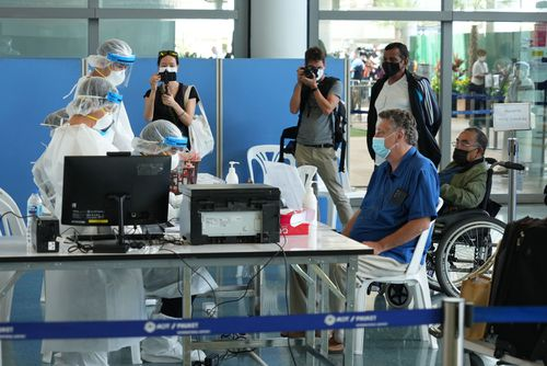 International travellers flying into Phuket must go through a series of screening checkpoints.