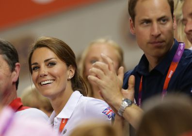 Prince William and Catherine Middleton watch the mens and womens sprinting at the London Olympics.