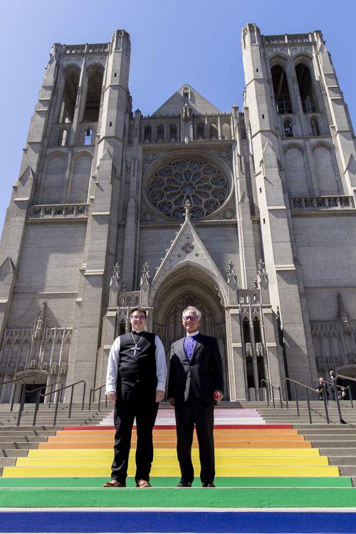 Bishop Megan Rohrer, left, and Bishop Marc Andrus stood on the rainbow steps before Bishop Rohrer's installation ceremony.