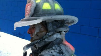 Some firefighters were getting doused with water, with icicles hanging down from their helmets. (Supplied)
