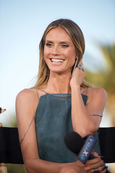 <p>Heidi Klum, 43</p> <p>For a sleek look that's not too severe, don't straighten to the ends to leave some movement.</p>