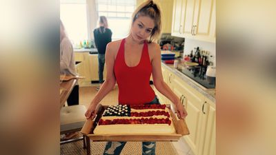 Joe Jonas shared this picture of rumoured girlfriend Gigi Hadid with an American flag cake cooked up at Swift's party. (Instagram)