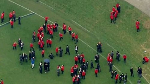 Students have been moved to the oval while authorities deal with the threat (9NEWS)