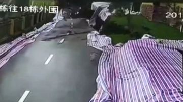 50 metre stretch of road collapses in China. Image: Supplied