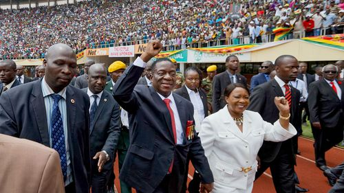 Emmerson Mnangagwa and his wife Auxillia arrive at his swearing in ceremony. (AAP)
