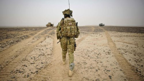 A British Army Officer walking towards British Army and Afghan National Civil Police (ANCOP) Observation Points in Helmand Province, Afghanistan. (Ben Birchall/PA Wire)