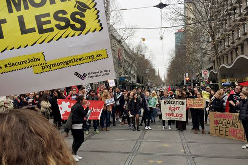 Police and hundreds of protesters gather outside the State Library of Victoria in August to challenge the government's cuts to higher education. (AAP)