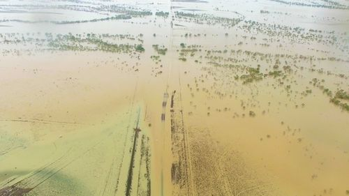 Winton businesses have stocked up on essential supplies, which will also be flown in if required, after all roads out of the town apart from one were cut off by floodwaters (Supplied).